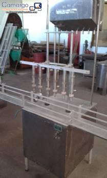 Empaquetador lineal con 6 boquillas de acero inoxidable Nocelli